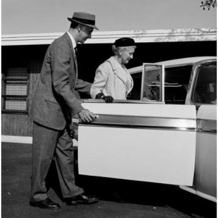 adult-son-holding-car-door-open-before-mother-poster-print-18-x-24_1444281.jpg