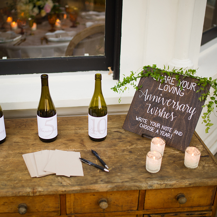 Sweet + Crafty | Stained Wood and White Calligraphy Wedding Anniversary Bottles Sign