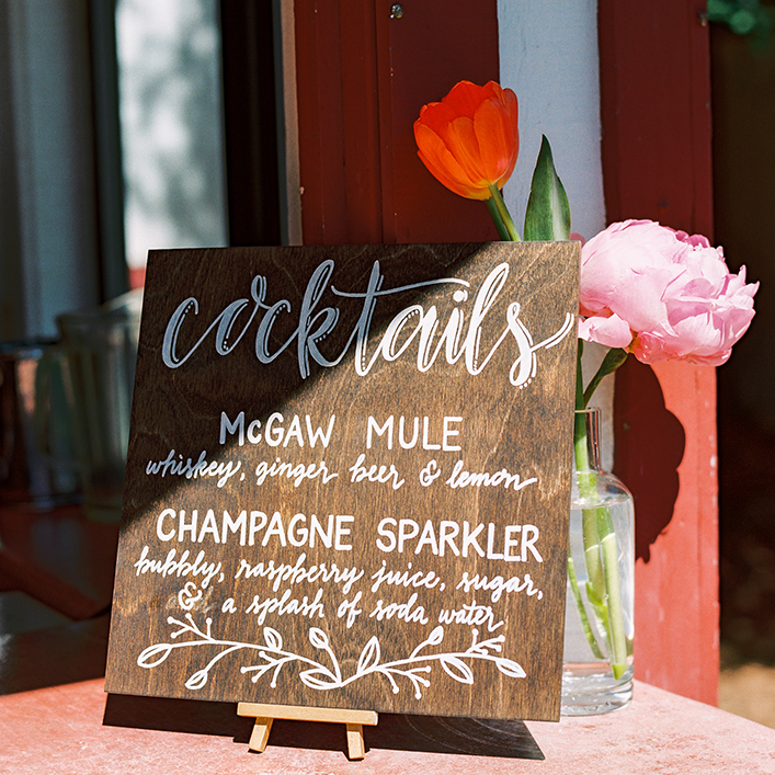 Sweet + Crafty | Stained Wood and White Calligraphy Wedding Bar Menu