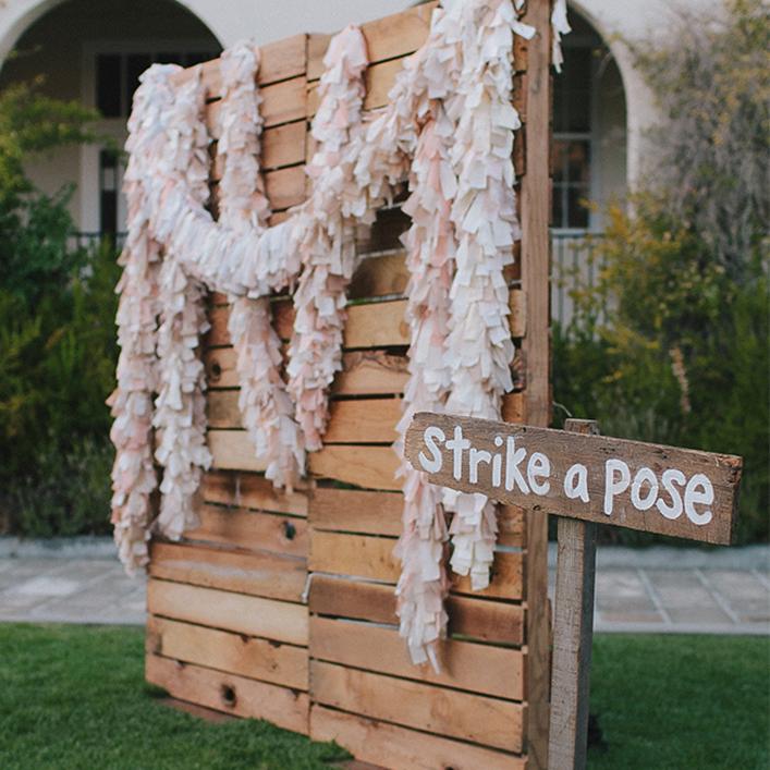 Sweet + Crafty   Wedding Photo Wall Fabric Boa Backdrop and Wood Sign