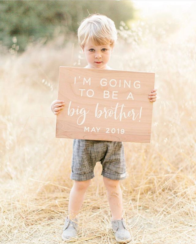 Getting to be a small part of some of life's best reasons to celebrate is what I love most about my job. Thank you for trusting me with such a special sign! This photo is perfection @littlemeglifestyle and what a handsome little guy who is going to be the best big brother to his baby sister soon @nicole.fantin! Congrats!!! #sweetandcrafty #pregnancy #pregnancyannouncement #baby #maternity #christmascardphoto #babygirl #mama #bigbrother #woodsign #handpainted #naturalwood #handpaintedsign #woodsignage #customdesign #announcementsign