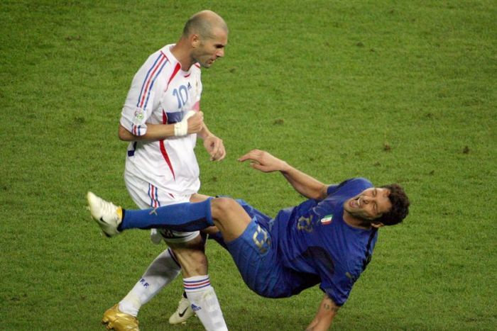Zidane gives Marco Materazzi a fierce headbutt during the 2006 World Cup (John McDougall/AFP)