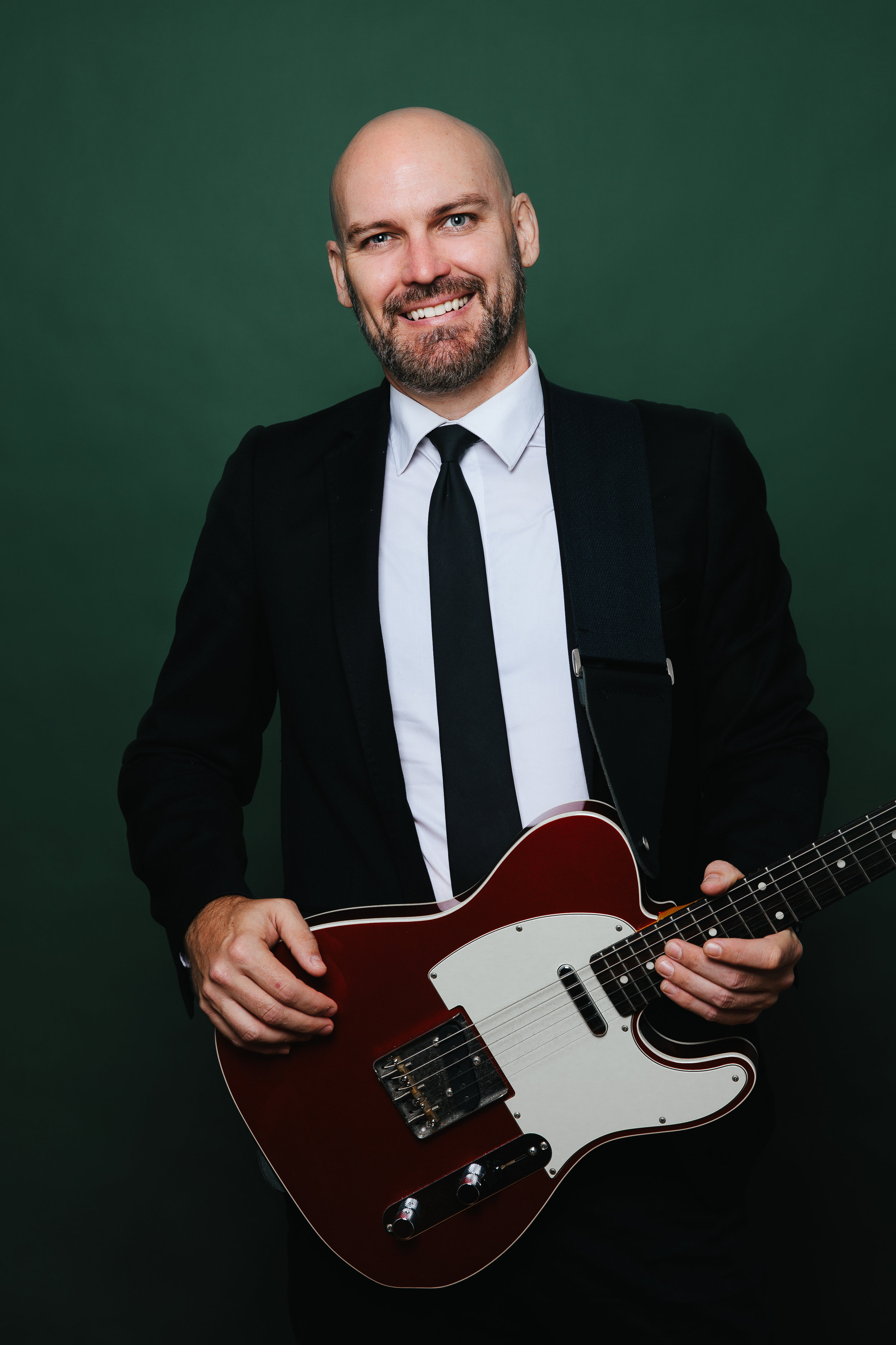 Tom - Singer + GuitaristTom is a charming artist who will keep the atmosphere buzzing. Whether it's afternoon tunes or rocking on into the night. Tom is a true pro.A classic artist who will mould to fit your vibe.