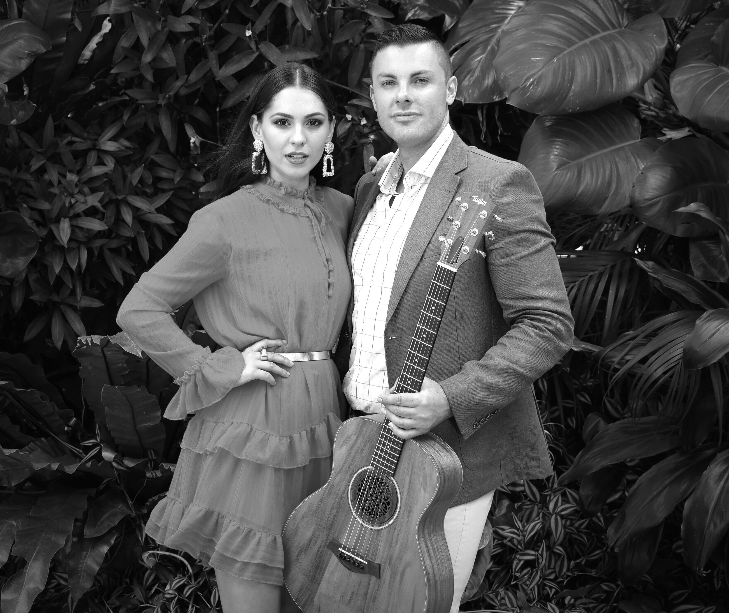 Nicole + Rob - Singer + Guitarist DuoFancy, fun and fabulous. Nicole and Rob are a match made in music heaven. Serious guitar skills, paired with dreamy vocals to create the perfect party vibe.An impressive duo that will cater to you and your event atmosphere.