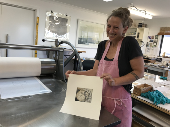 Suzi very proud of herself with her first etching. A two colour plate softground!