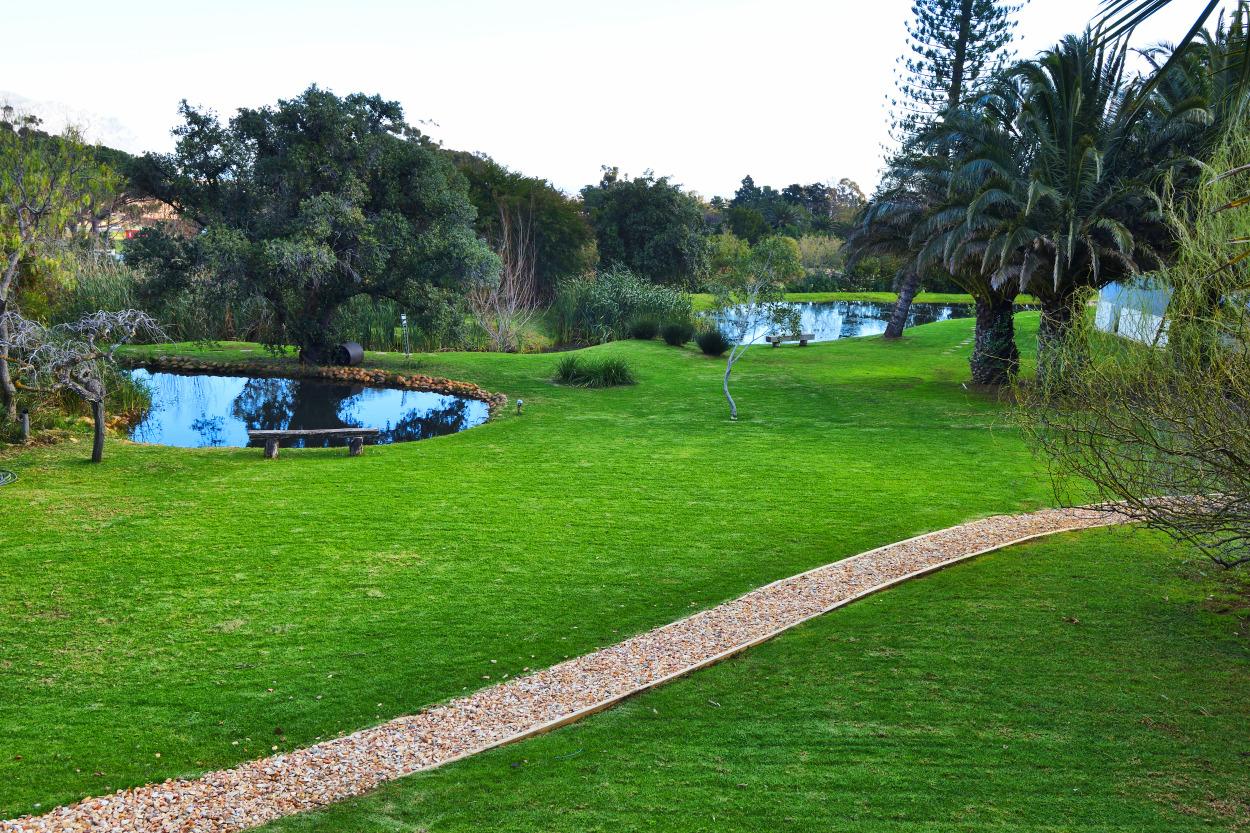 Beautiful garden walk reminiscent of a golf course
