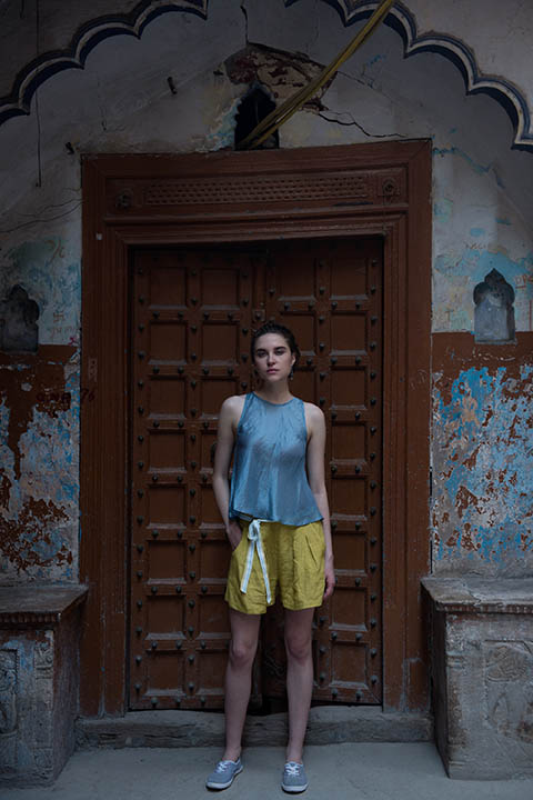 YC2T36 Bias carolina blue silk tank top with button and tassel detail at back Alt colour option: Navy blue  YC2SH11 Mustard flared linen shorts with a tie up belt