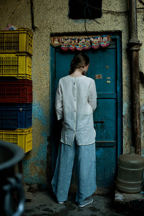 YC2T17 White cotton linen asymmetrical top with tassel details on sleeves and centre back buttoning placket  YC2P5 Light blue printed linen pants
