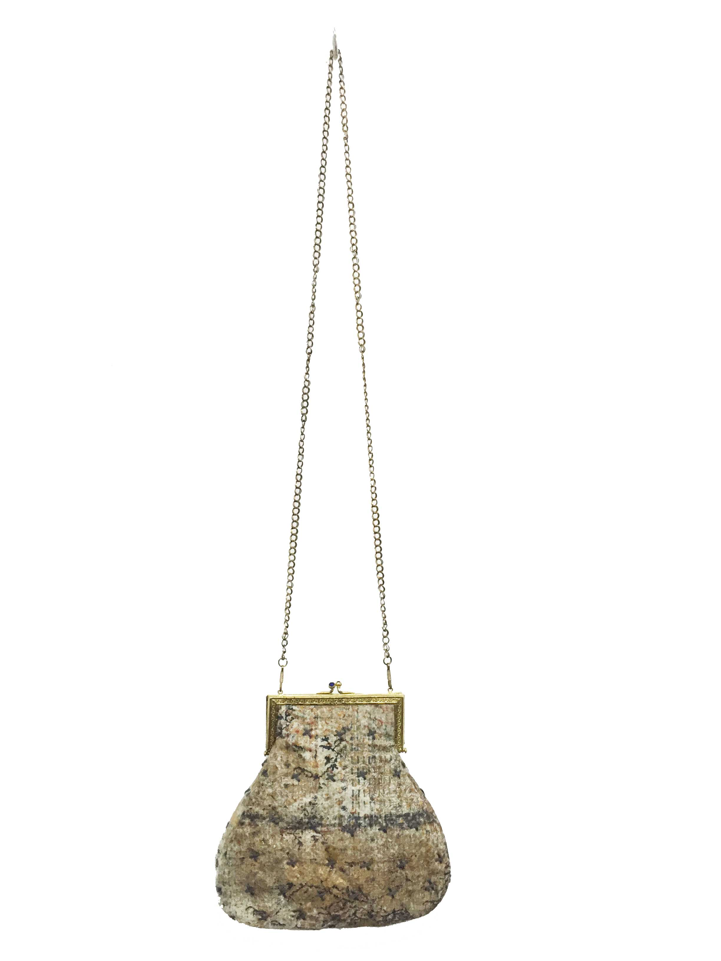 The Golden Jungle At Twilight  The golden jungle bag has been hand painted using shades and textures of blue with floral golden patterns. Specs of accent colours can be observed from piece to piece just like the unpredictability one faces when roaming in a forest under moonlight.