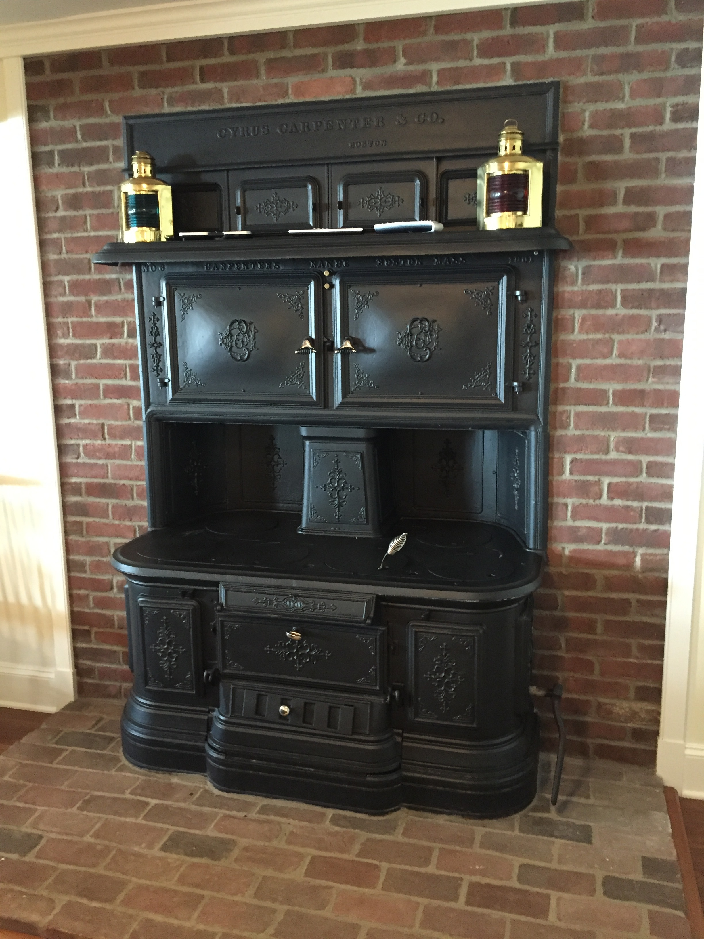 "Saved from the kitchen of the old home, this brick oven stove is now in a room that the current owners call ""The Grotto""."