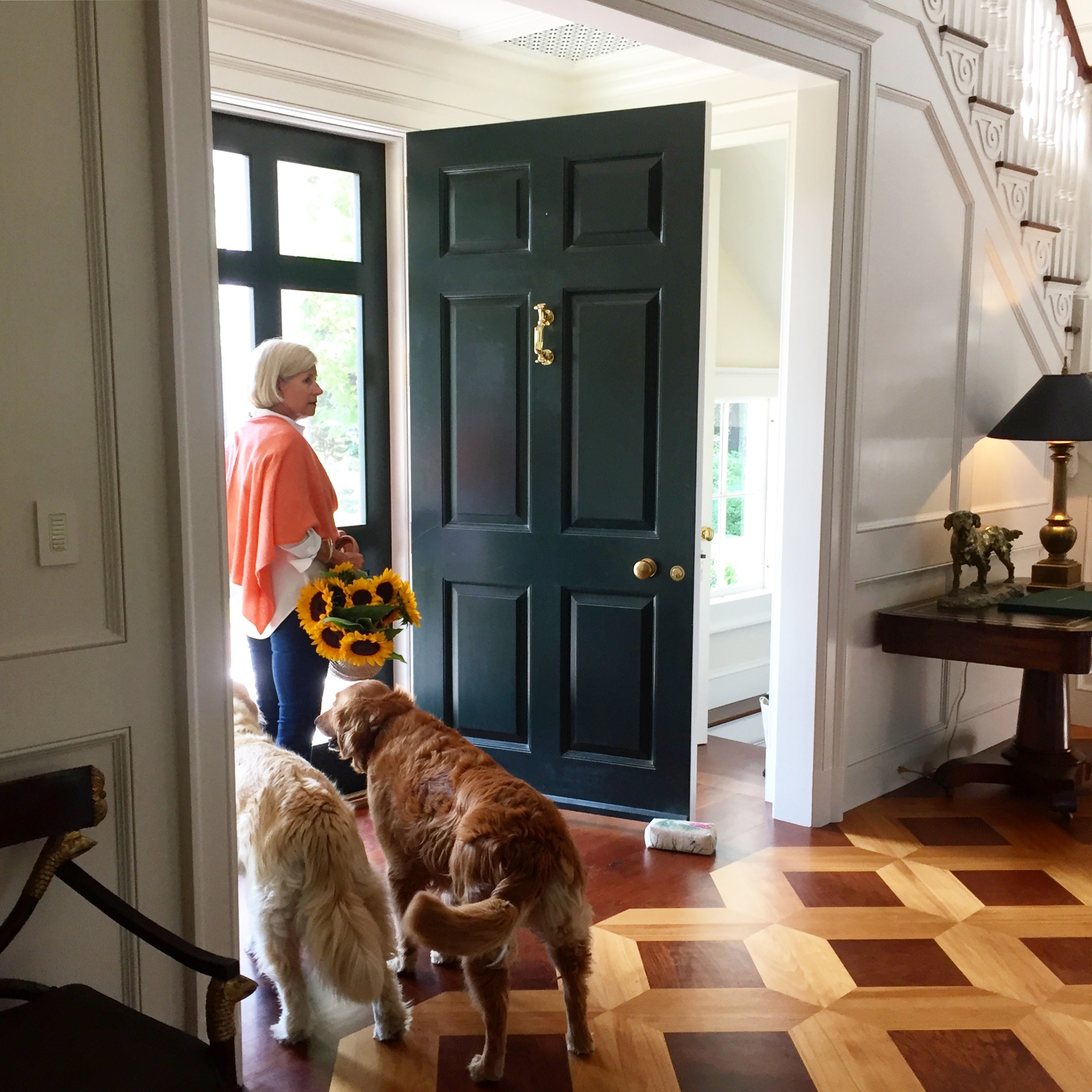 Lauren and her three dogs (one is already outside) at the entryway of woodstone - photo: linda davis