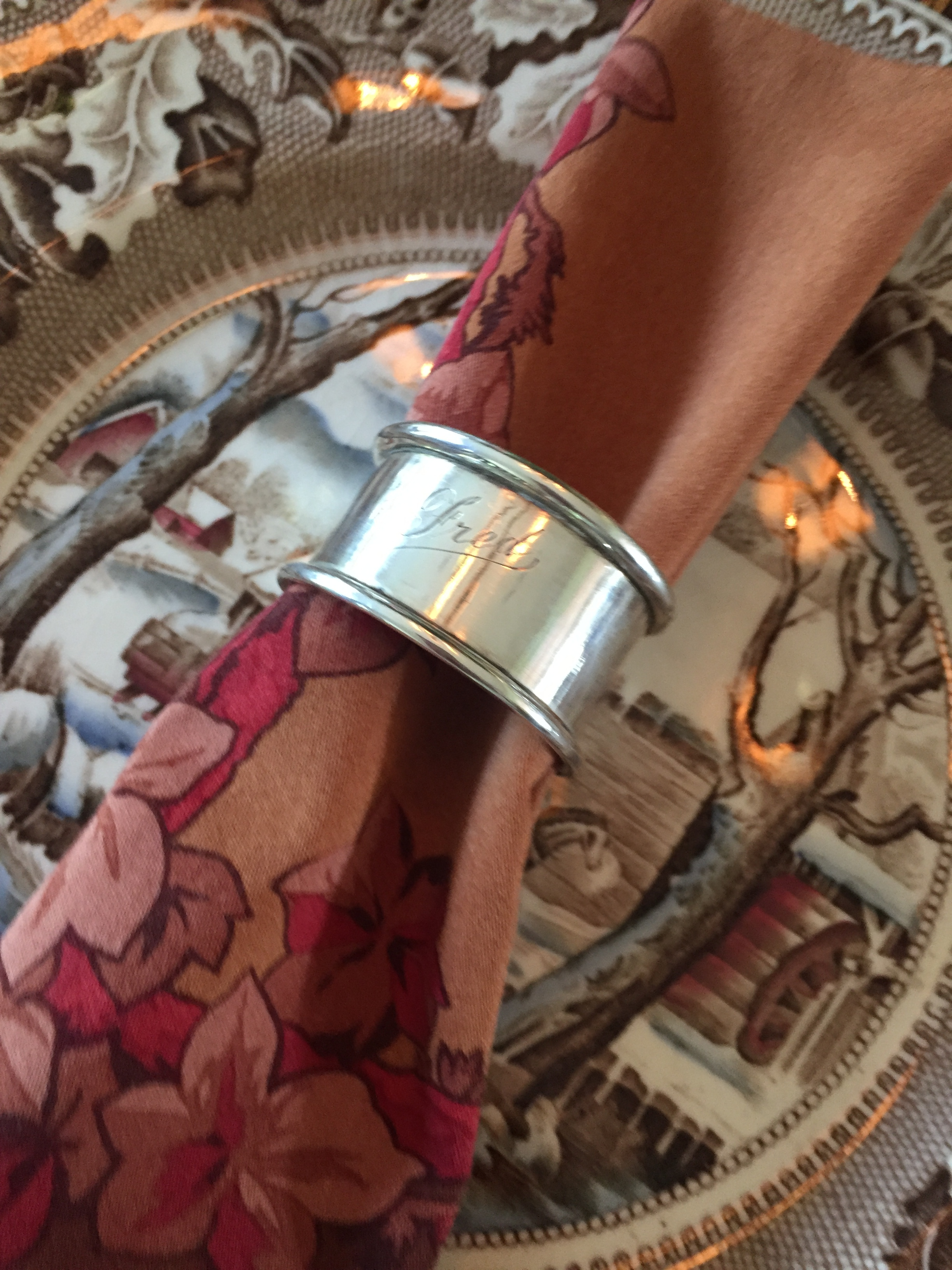 silver napkin rings that were purchased at an antique store are used at each holiday gathering. no fred in this family, but each holiday the fun begins to see who gets fred's napkin ring - photo: linda davis