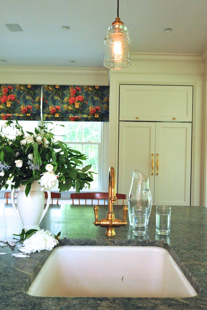 Adorned with a brass faucet, a second sink was placed in the kitchen's center island. Photo: Cheryle St Onge