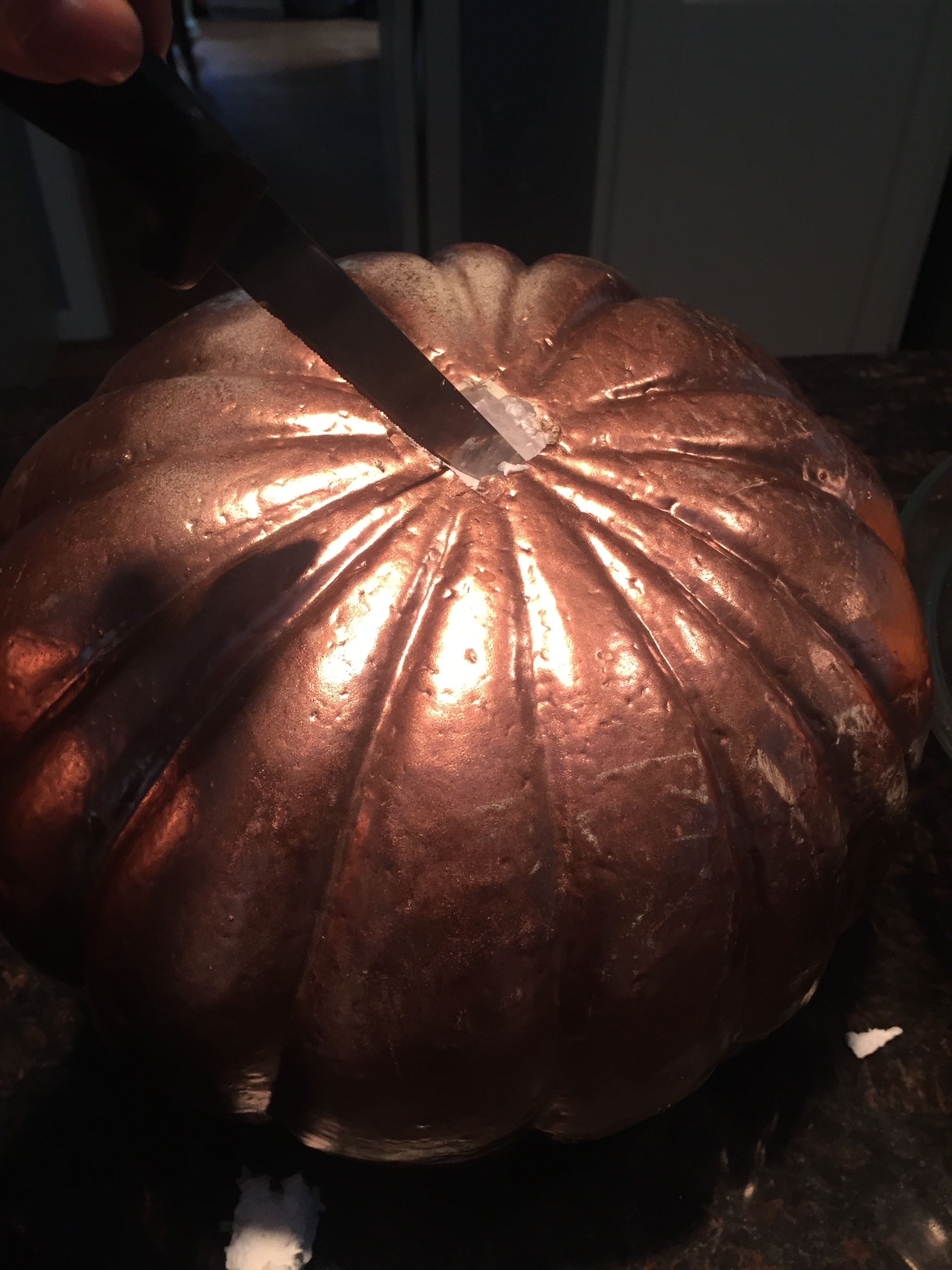 carving a foam pumpkin