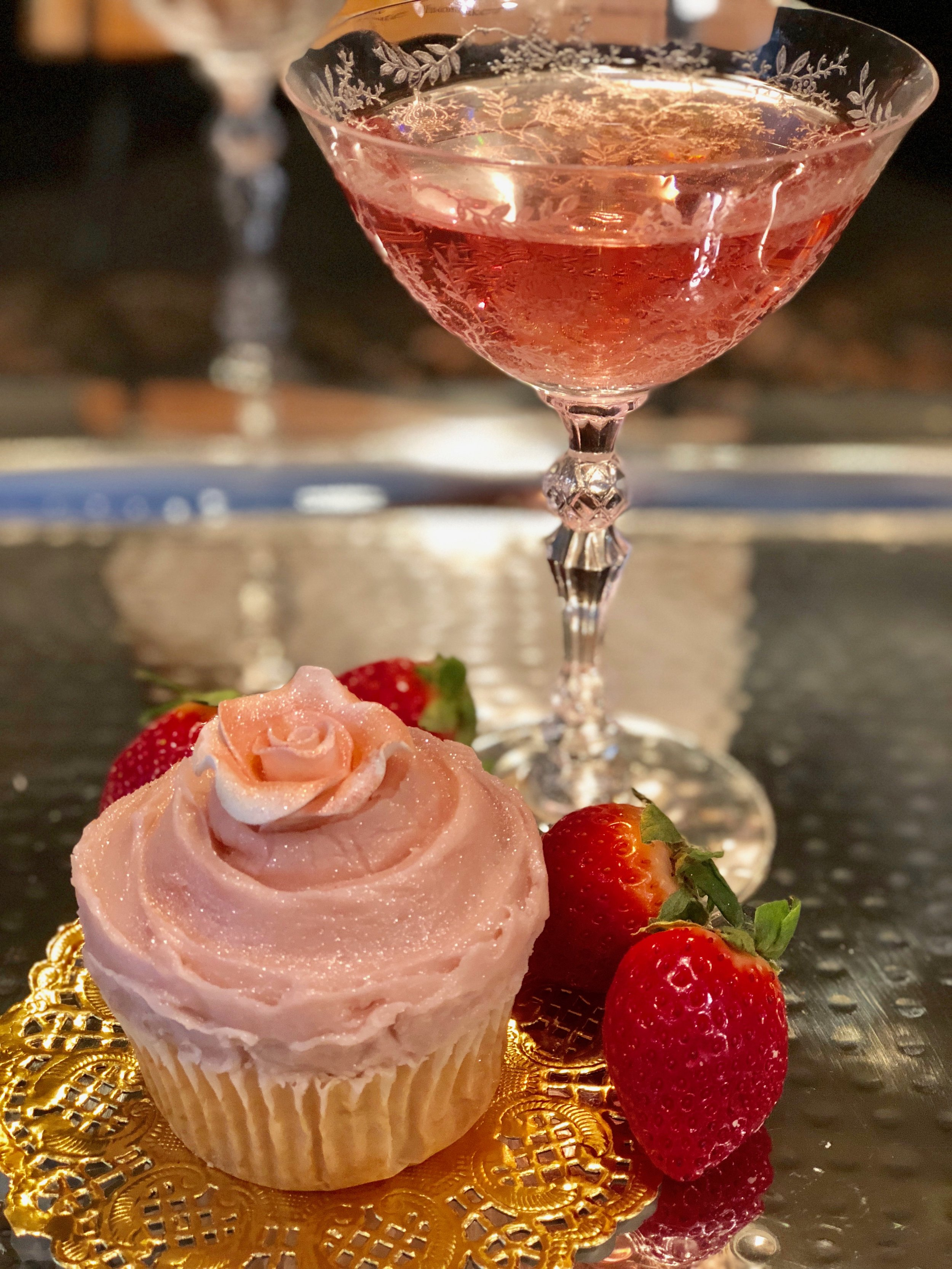 champagne cupcake and coupe of champagne .jpg