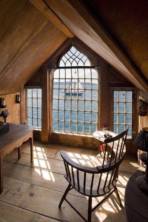 ornate window overlooking ocean