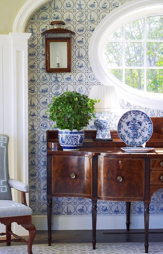 Oval window over sideboard blue and white china