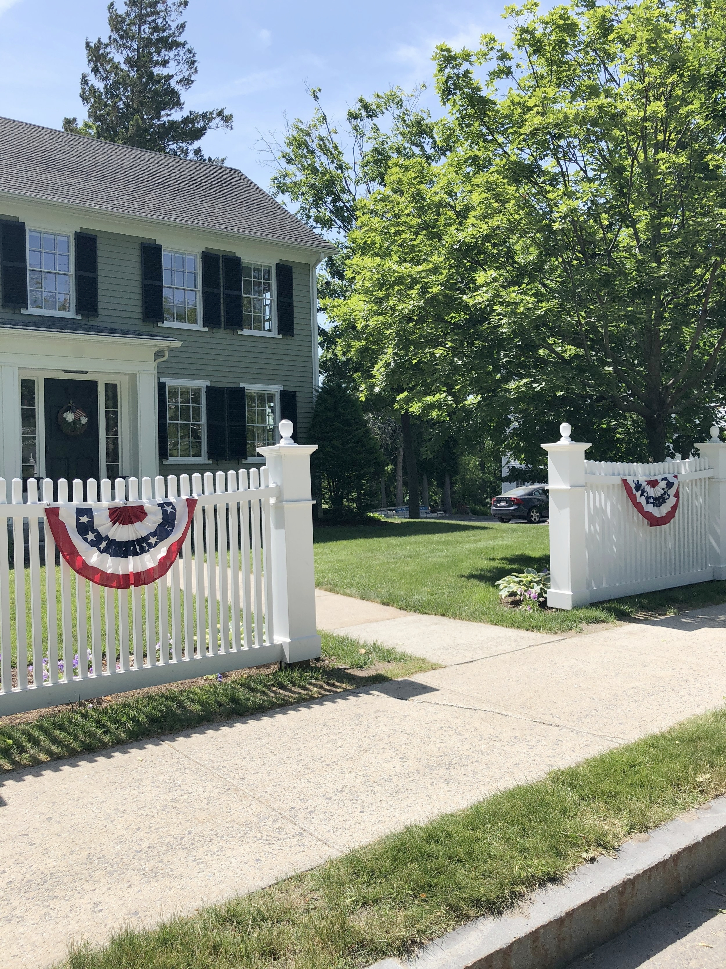 fourth of July bunting on fence