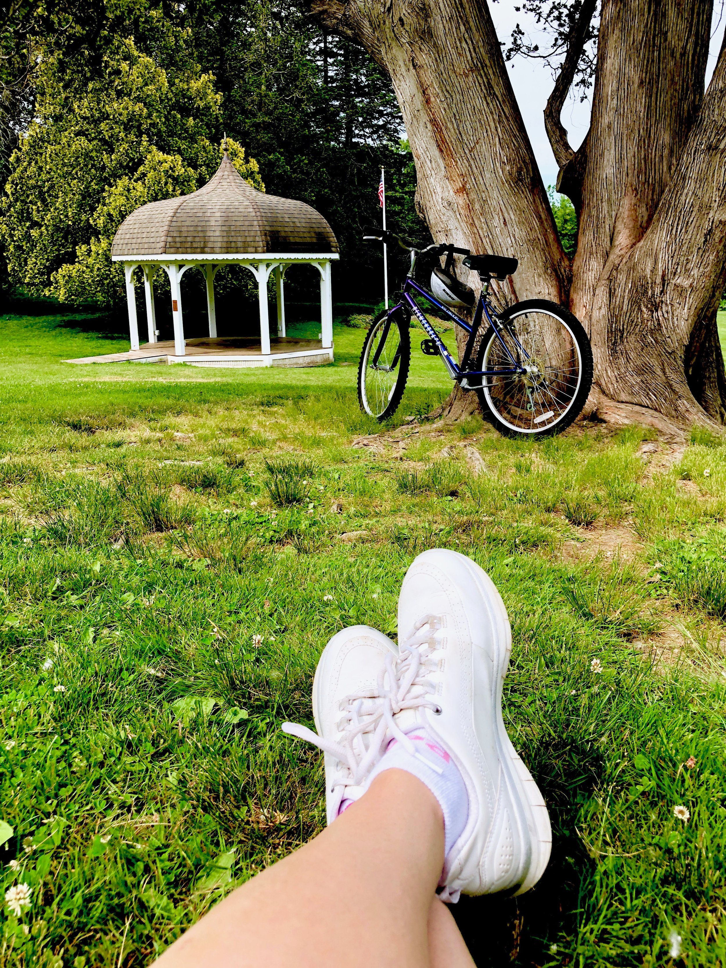 Taking a break by the band stand after an early morning bike ride. My  white skechers  are used to walking, but I think biking is going to be happening a lot more!