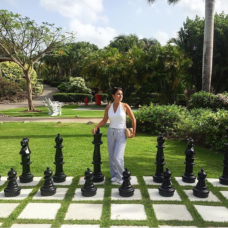 Playing chess Nevis Four Seasons.jpg