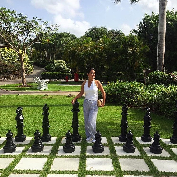 Look out King, here comes your Queen! I found this giant chess set while on our honeymoon in Nevis.  Here is a similar set.  A similar halter top  here  and a comfy looking pair of Palazzo pants, similar to mine,  here