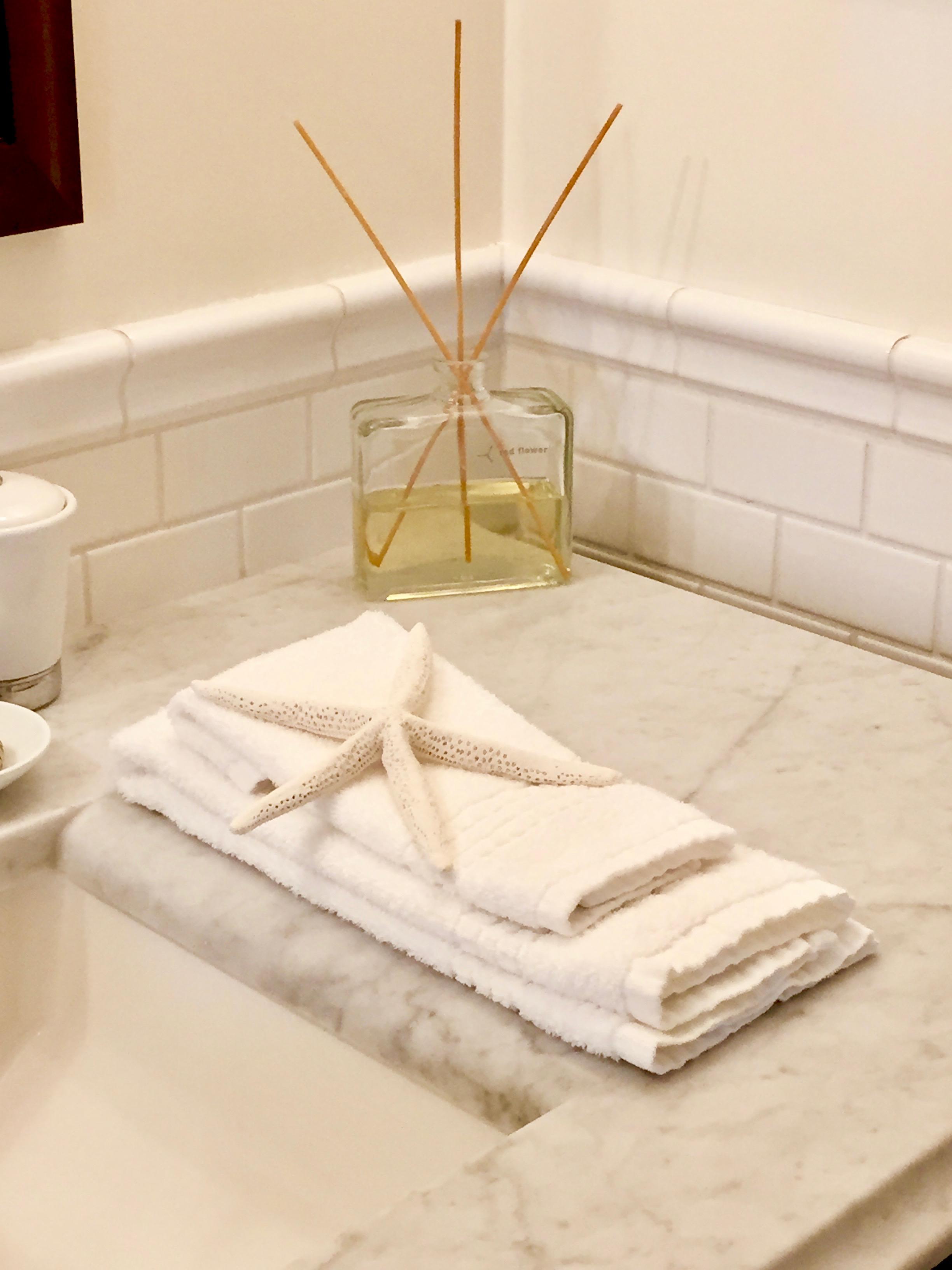 fragrance sticks in luxury bathroom