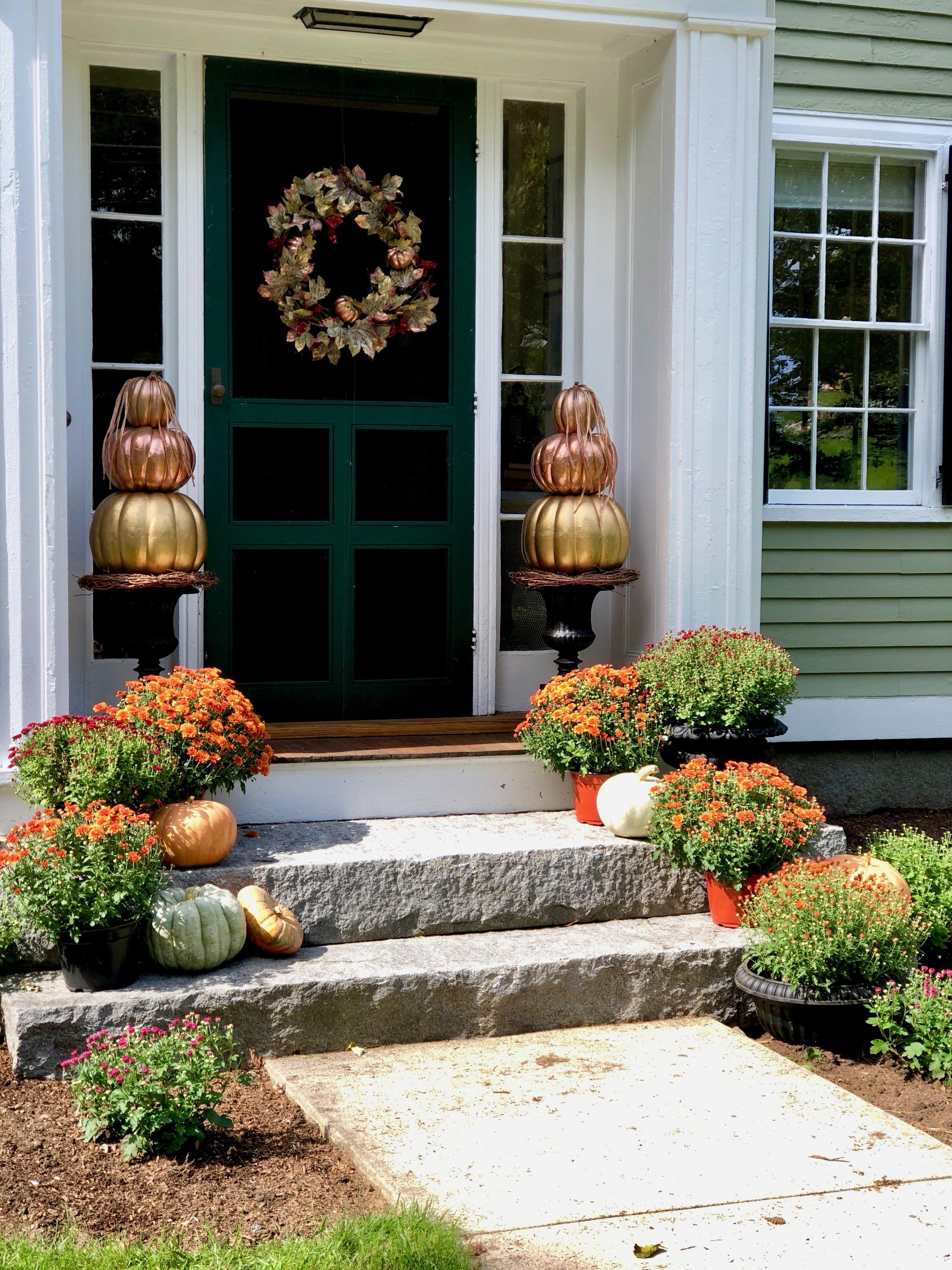 metalic pumpkin topiaries front door.jpg