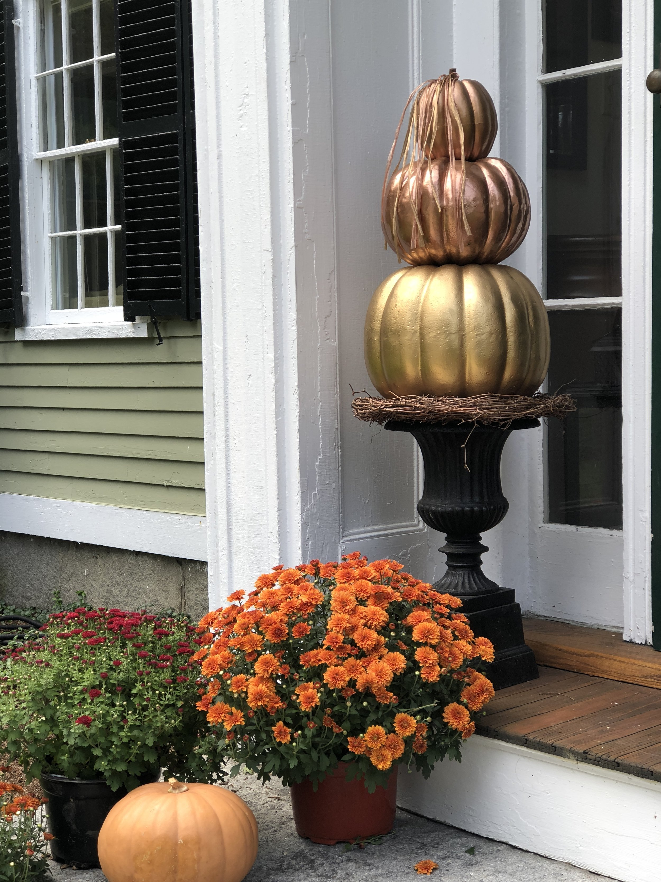Colonial home decorated for fall in New England