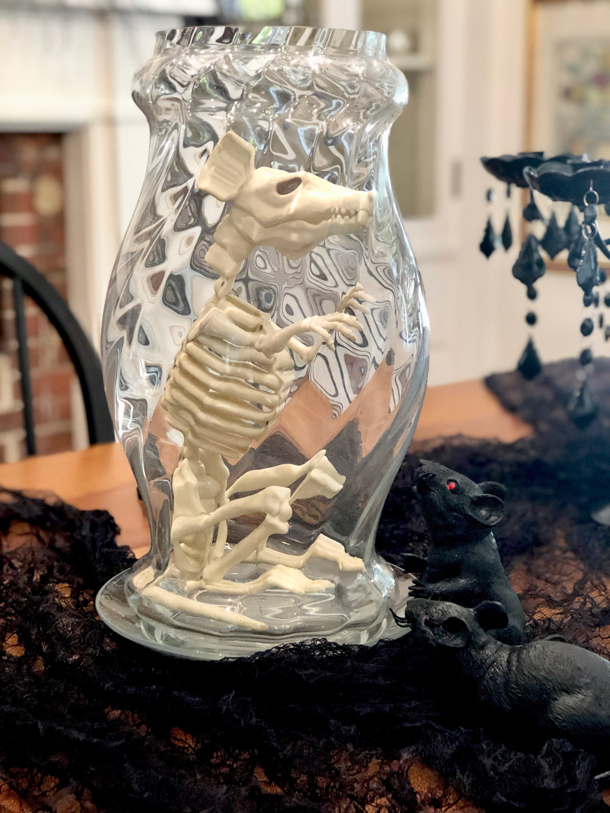 rat skeleton in glass candle hurricane