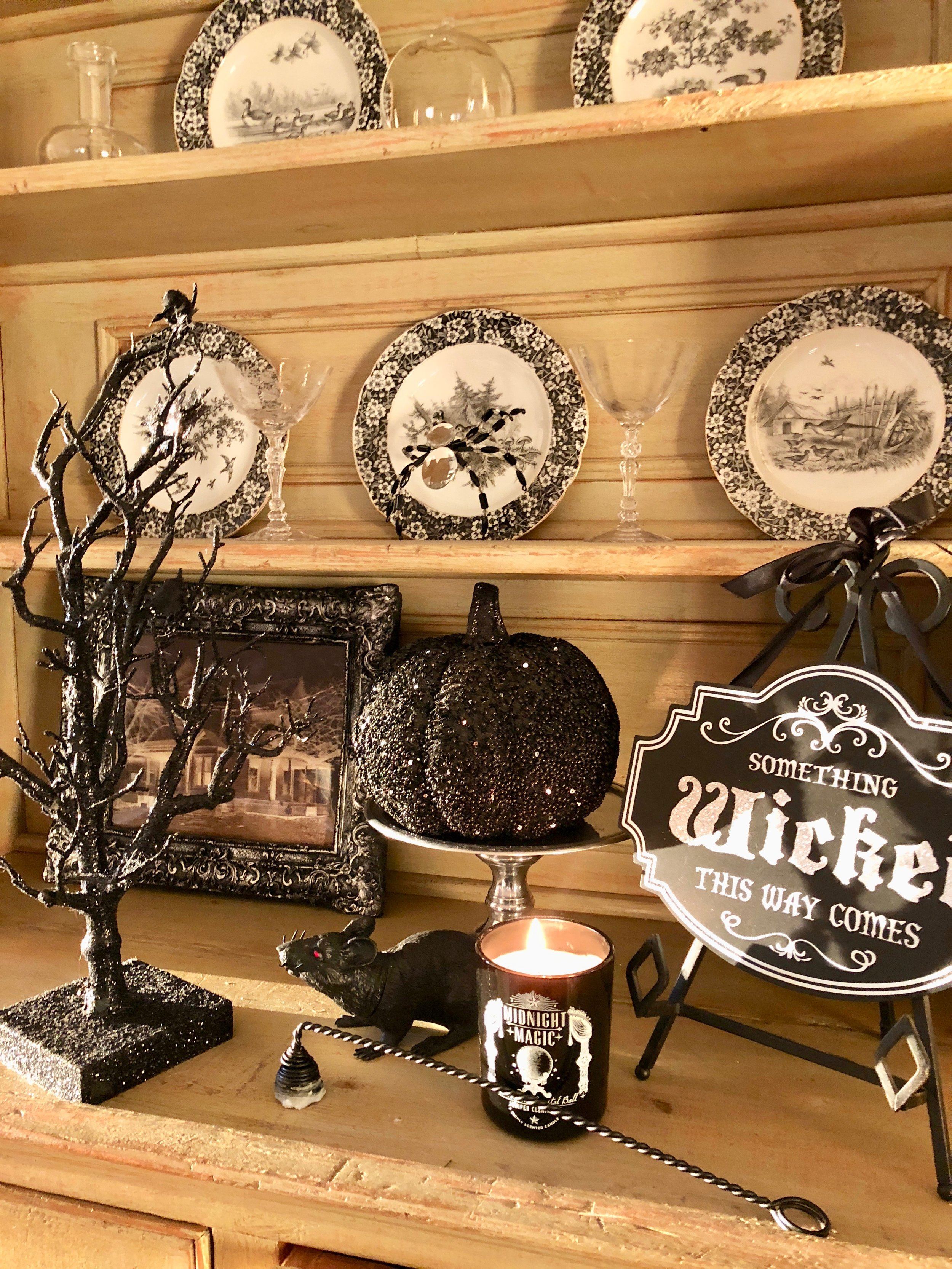 hutch decorated with black and white halloween decor