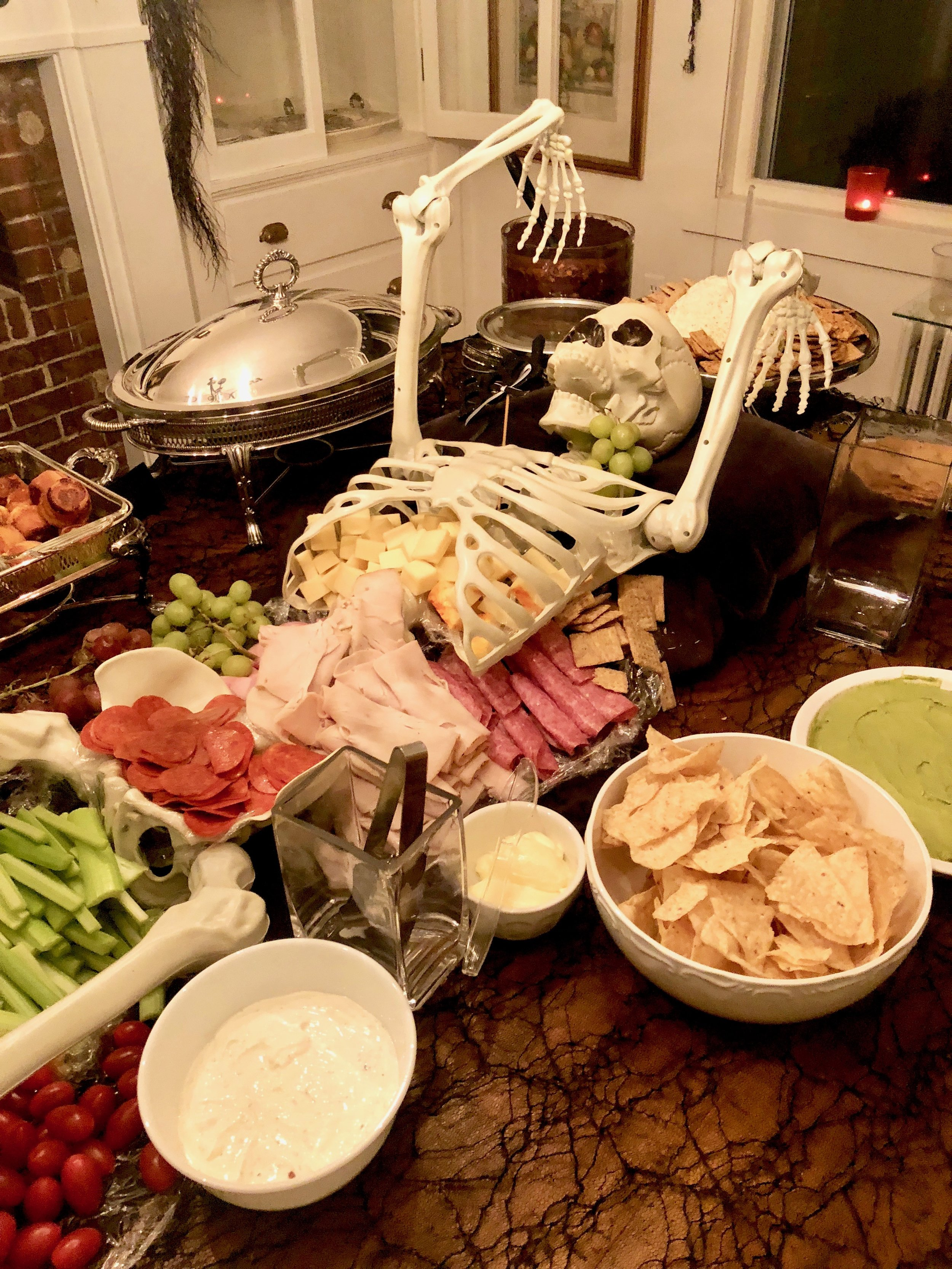 skeleton on dining room table for appetizers