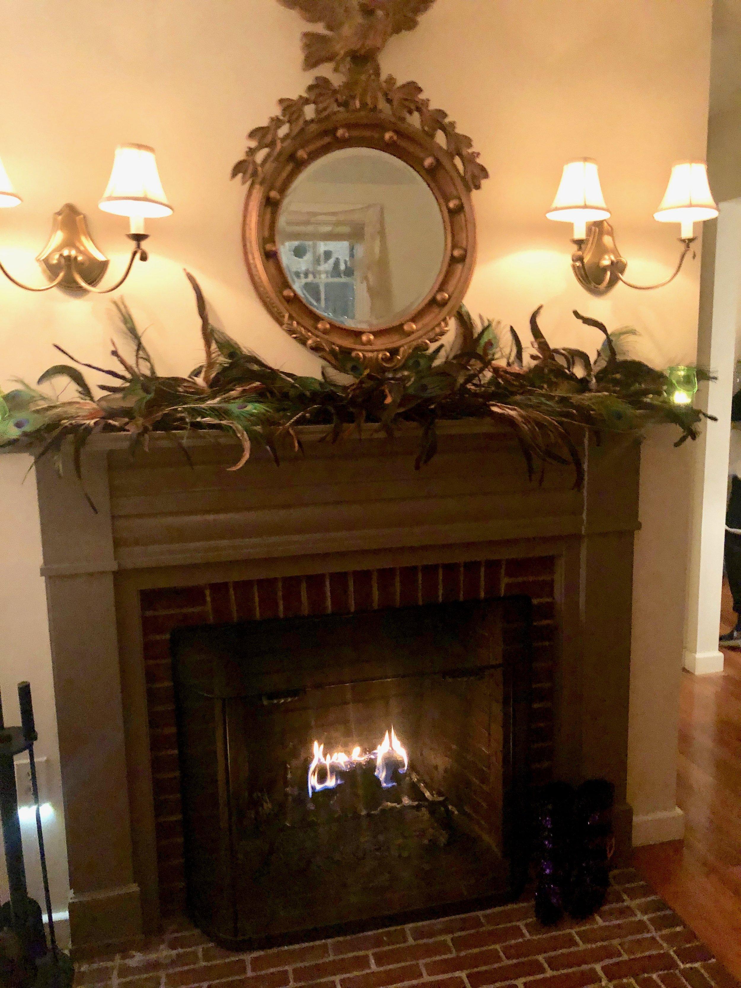 elegant fireplace halloween feathers on mantle