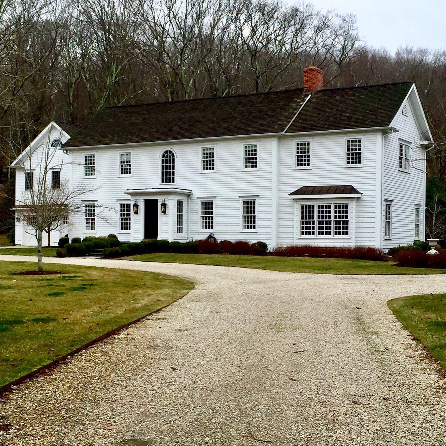 White New England style home 12 over 12 windows portico peastone driveway Newtown CT New England USA .jpg