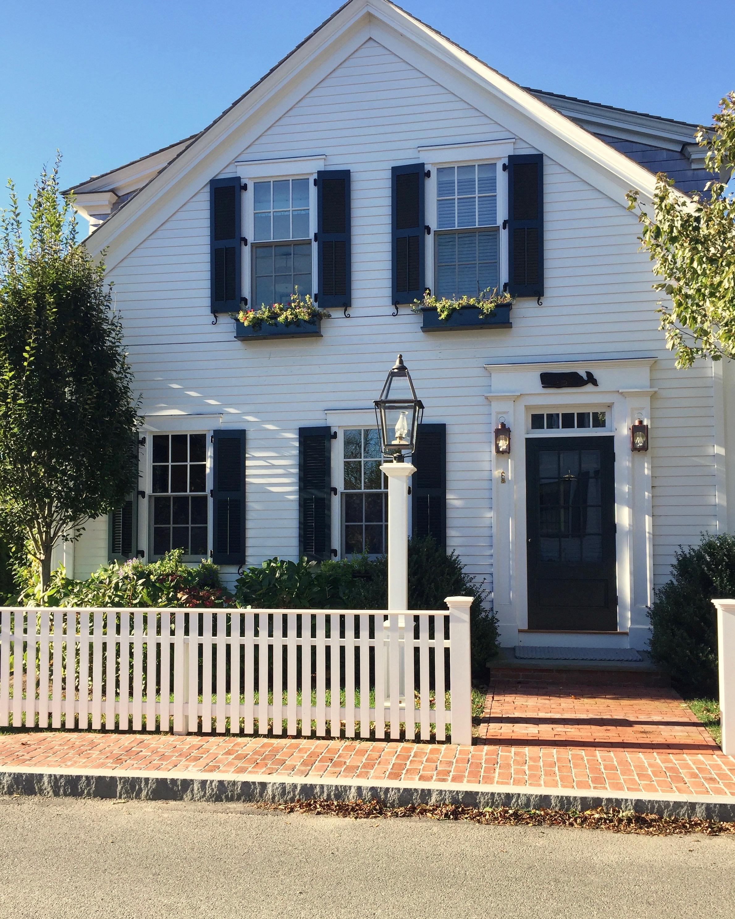 marthas vineyard new england massachusetts  white antique home  green shutters green door whale sign.jpg