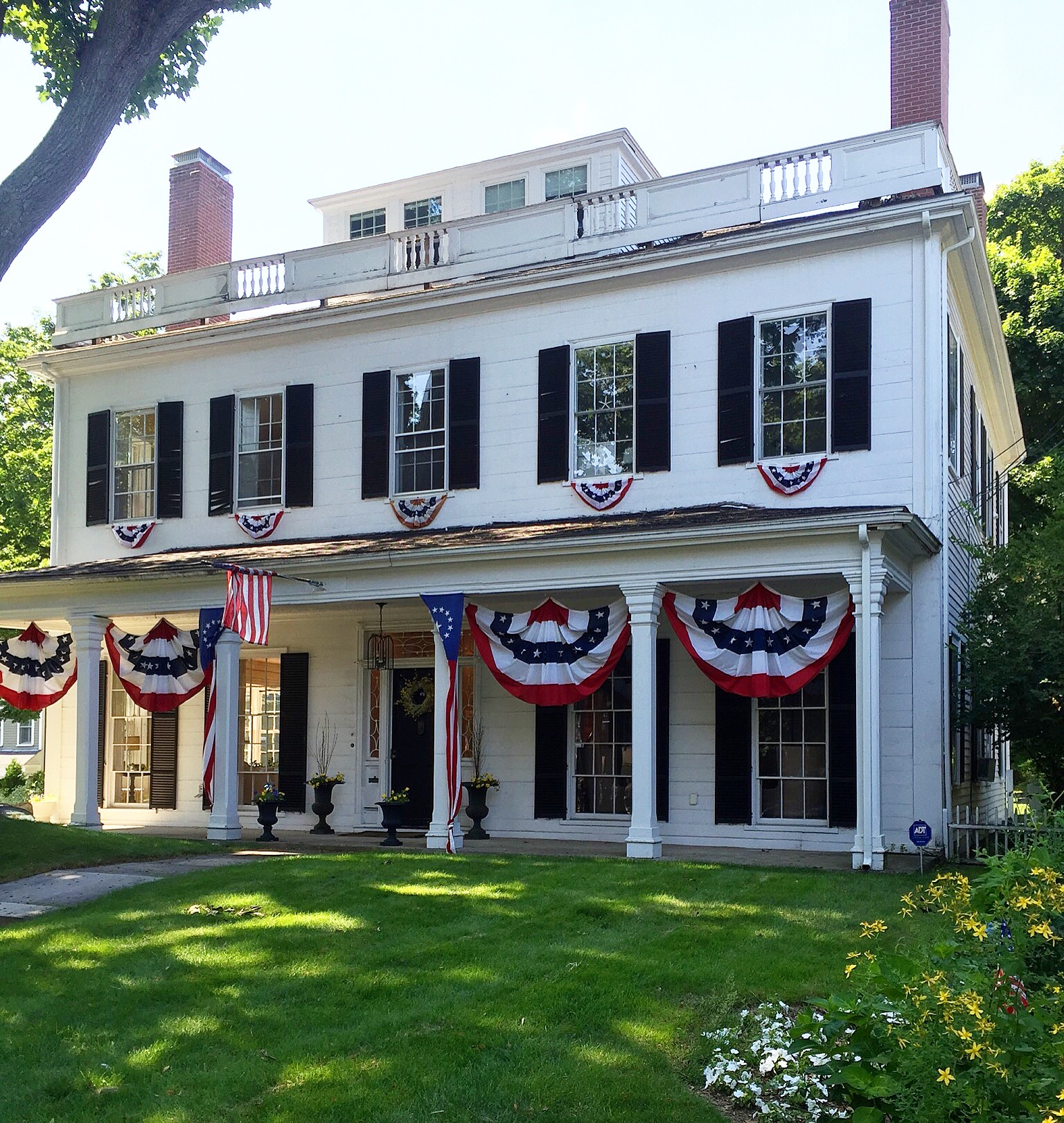home in marblehead ma with patriotic bunting new England antique home