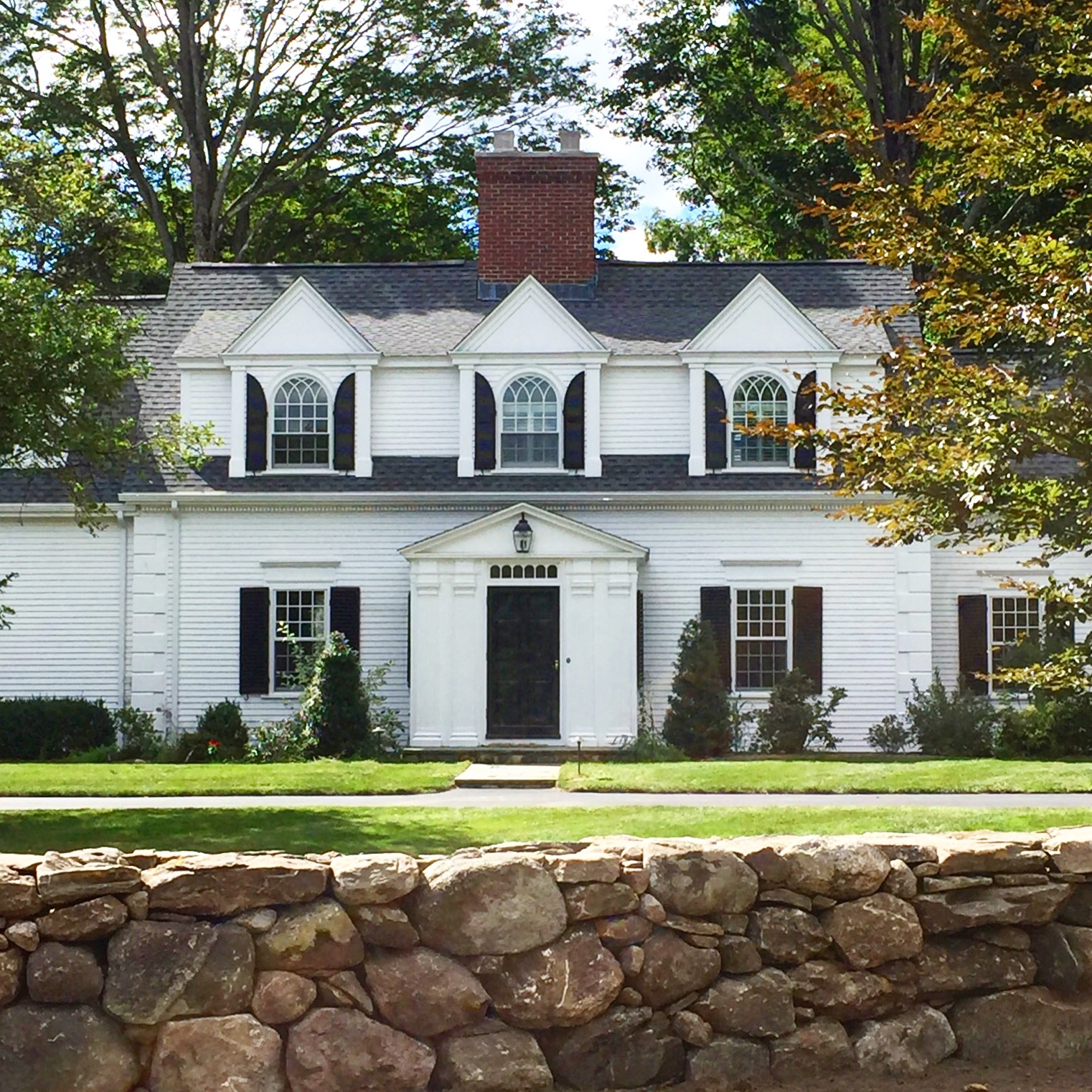 Concord MA antique home with arched window shutters painted white with white trim Concord MA historic New England style home.jpg
