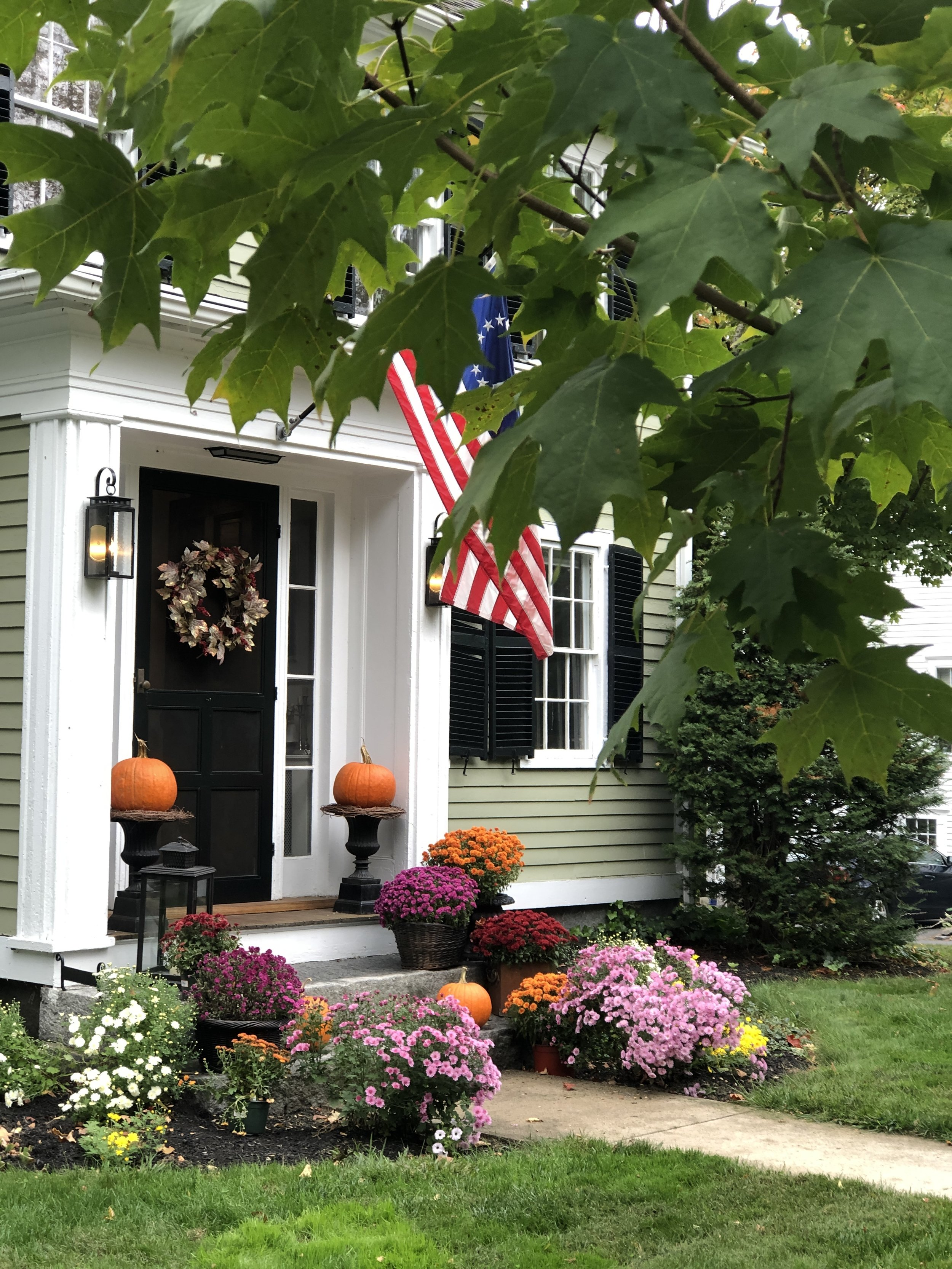 front steps decorated for fall.