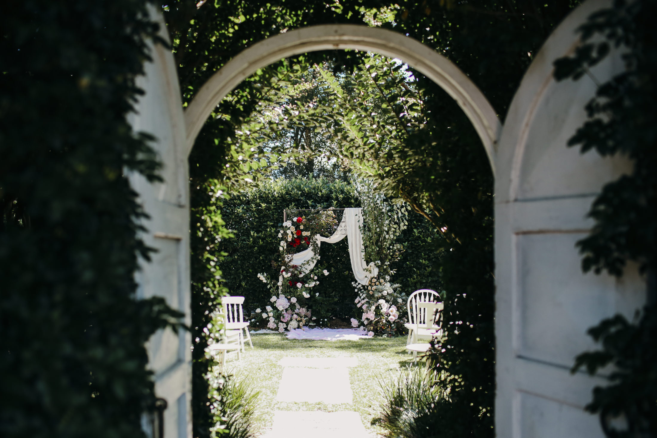 Amelia + Jono Wedding Secret Garden Arbour ceremony setup