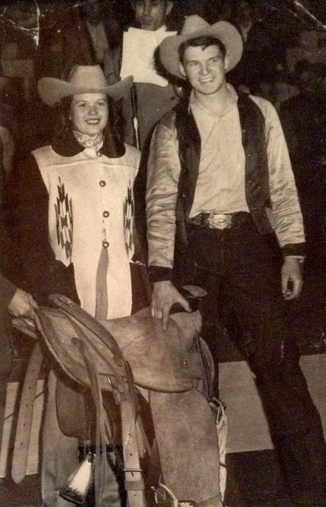 Jim Carrig, 1950 at the Cow Palace in San Francisco, receiving his saddle for first place in Bareback.