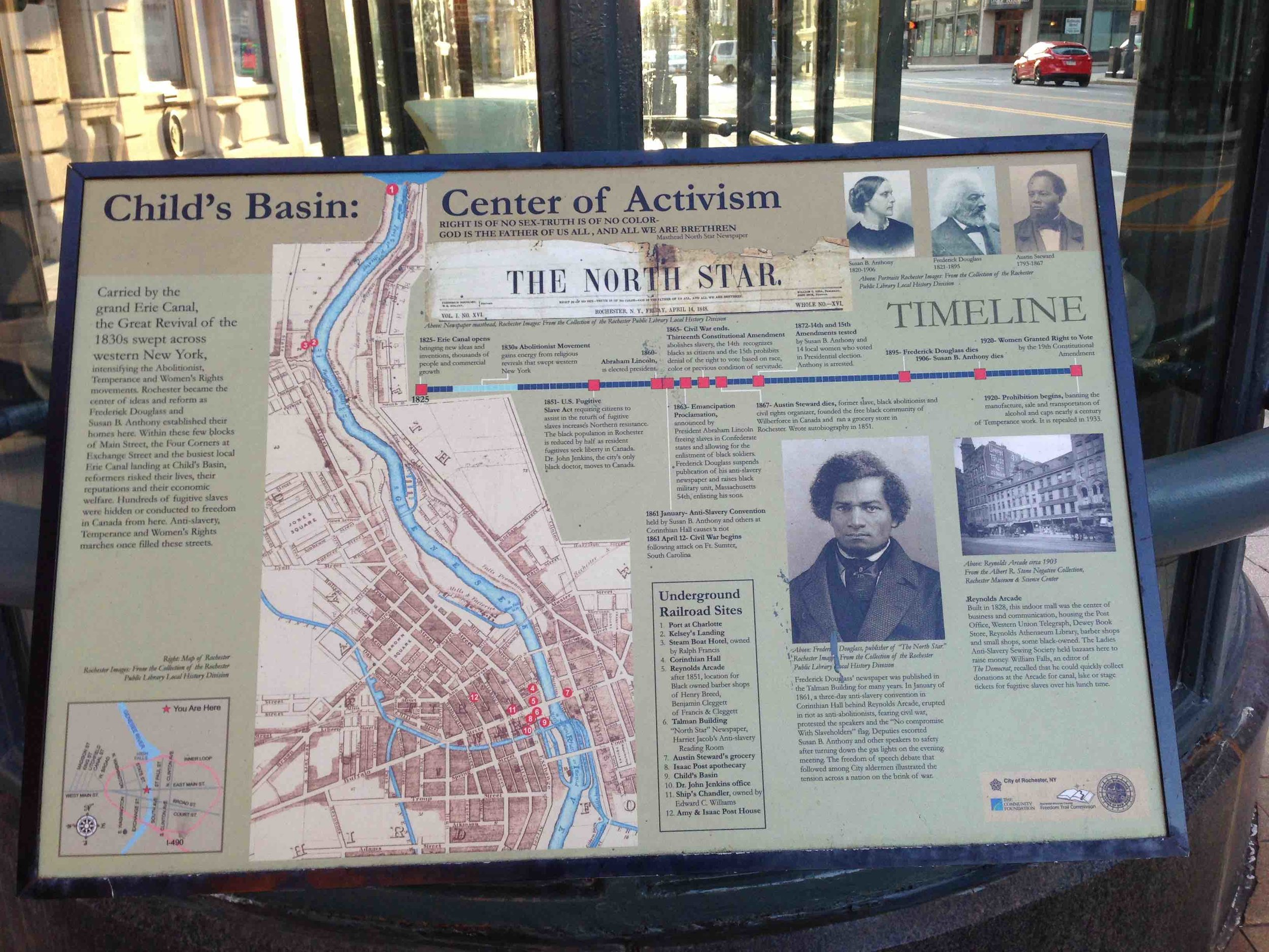 A historic sign in Rochester tells some of the city's 19th century history.