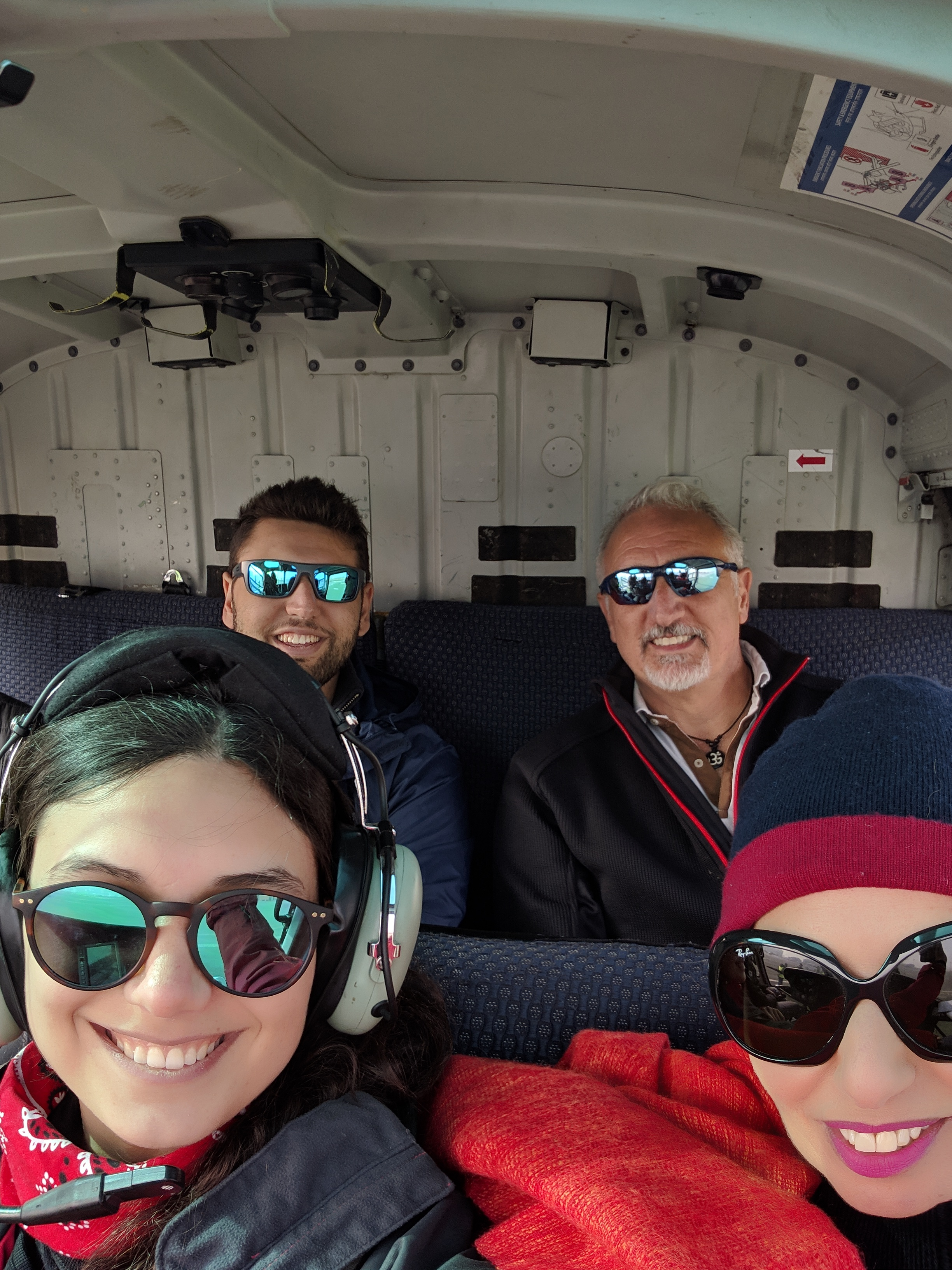 The four of us in the cabin of a helicopter on the way to Mt. Everest