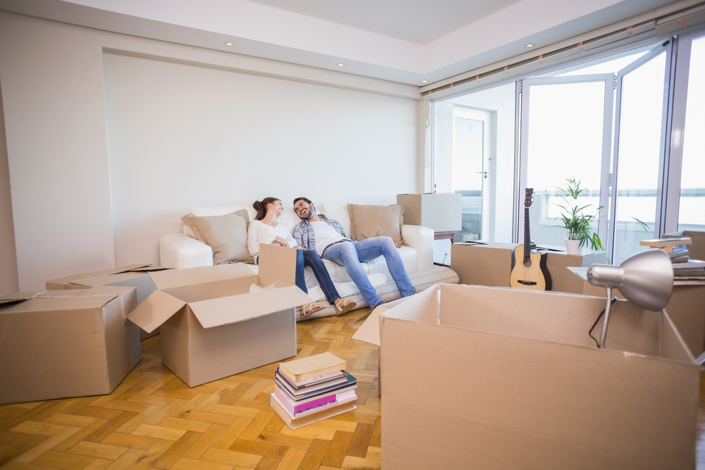 A couple discussing what to move first during the moving process