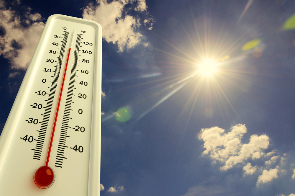 hot summer weather with a thermostat