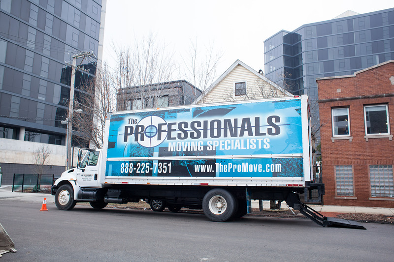 The Professionals Moving Specialists moving truck