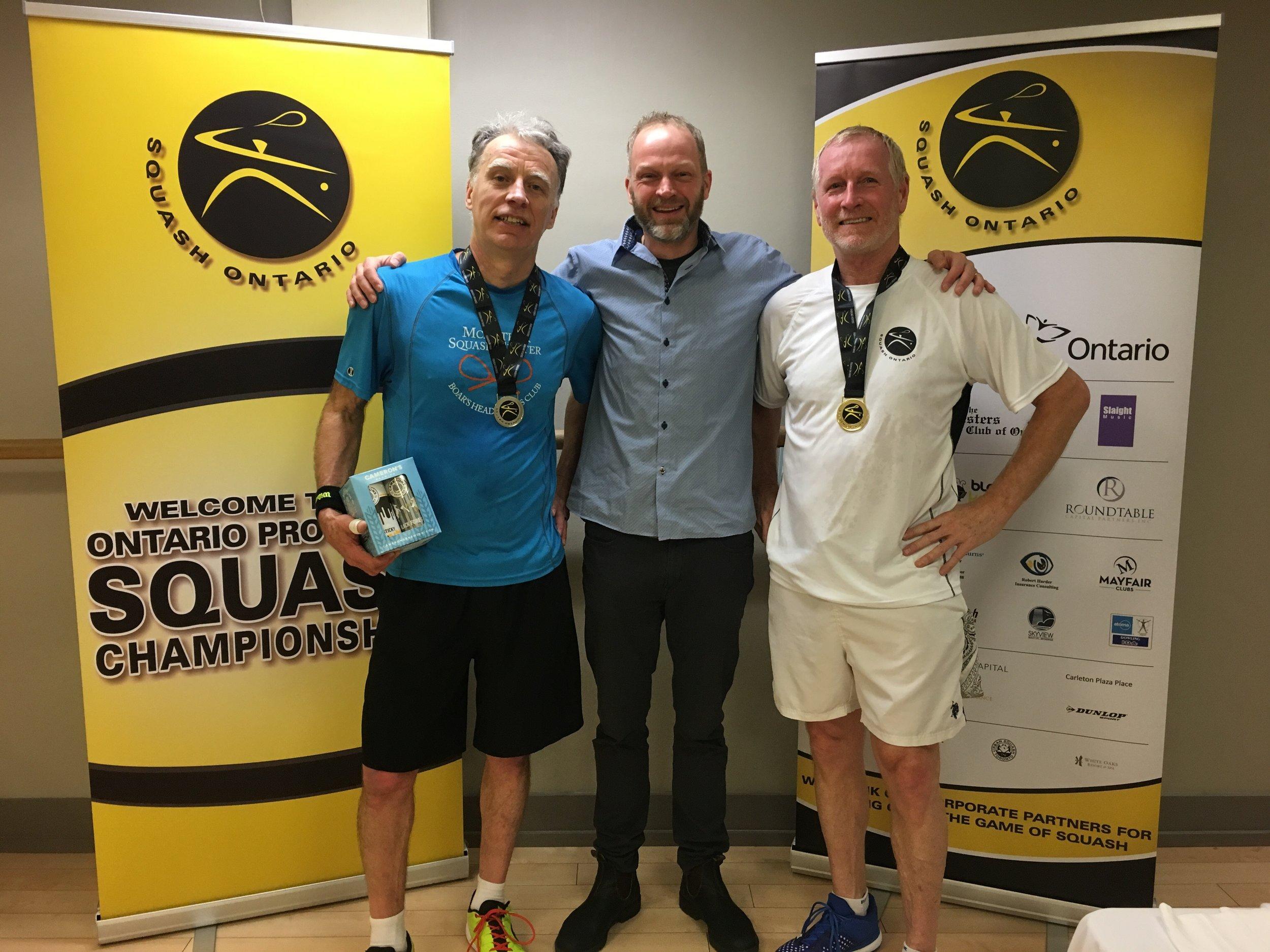 L-R: Wayne Weathehead, Squash Ontario's President Bruce Marrison, Guy Gordon
