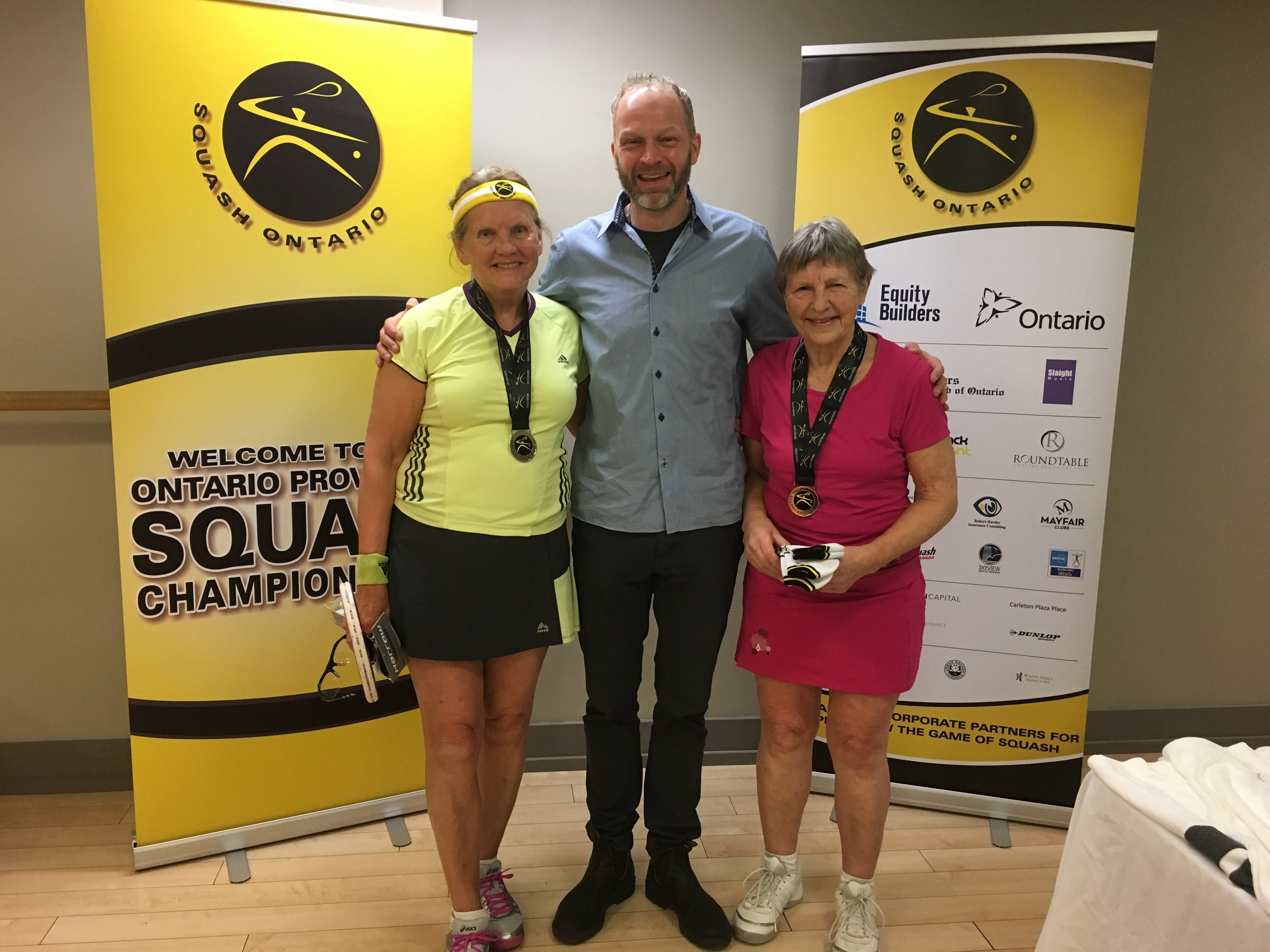 L-R: Christine Kogon, Squash Ontario's President Bruce Marrison, Penny Glover