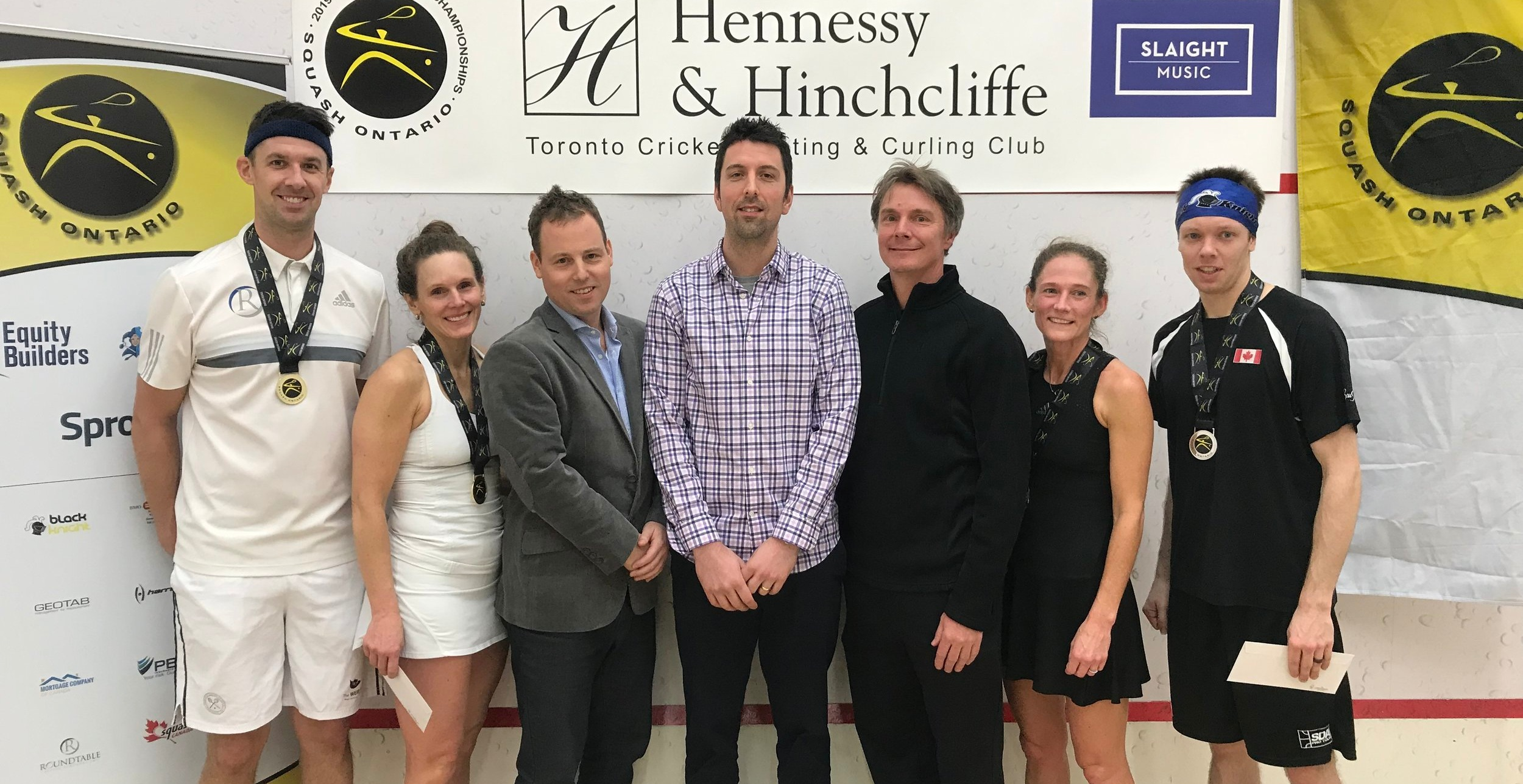 Left to right: Mixed Open Champions Scott Arnold and Seanna Keating, Squash Ontario Executive Director Jamie Nicholls, Tournament Chair Robin Clarke, Tournament Referee Mark Warren, Finalists Stephanie Hewitt and Fred Reid. Front row: Maya Deratnay and Georgia Baldwin.