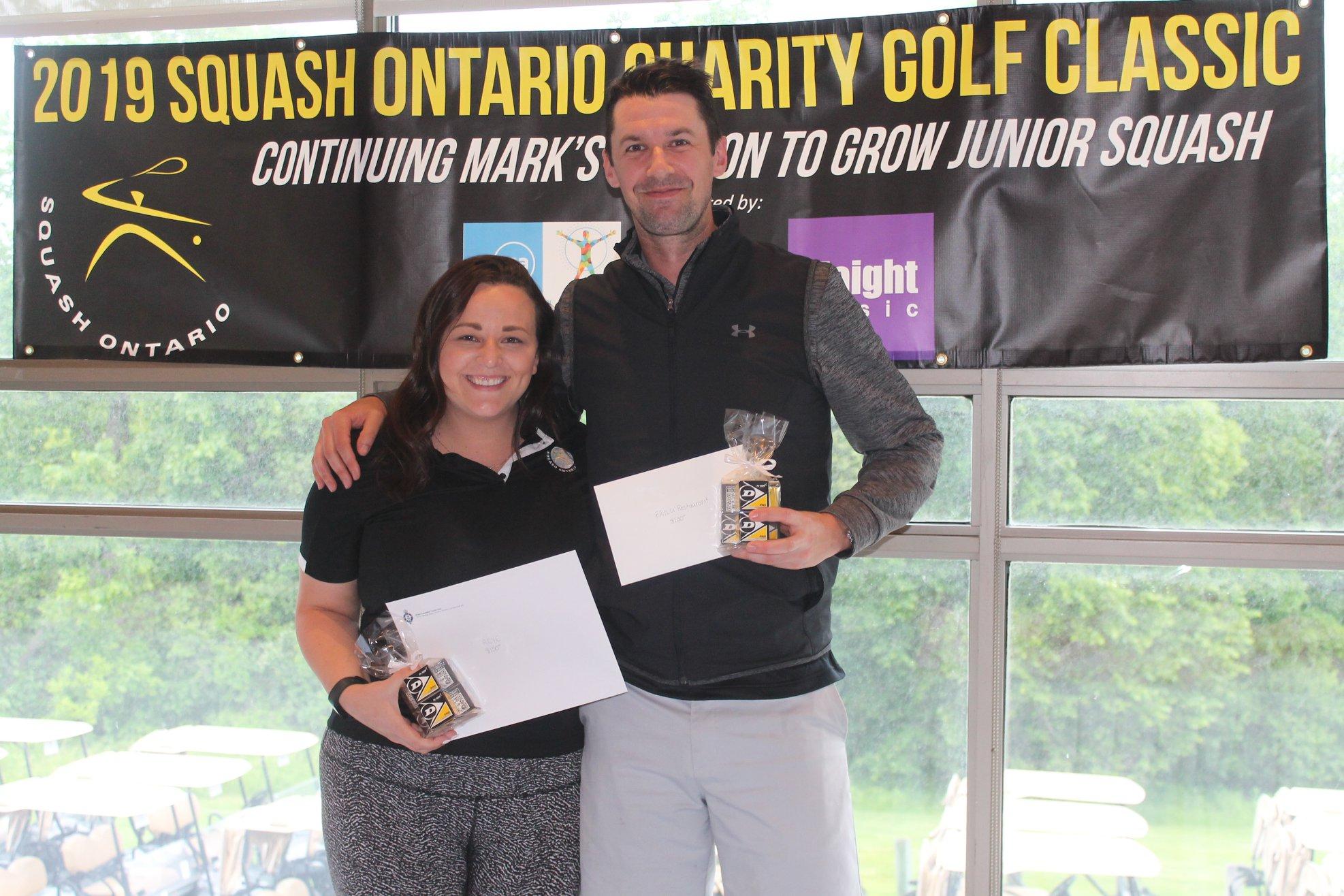 Longest Drive winners Lauren Sachvie and Scott Arnold