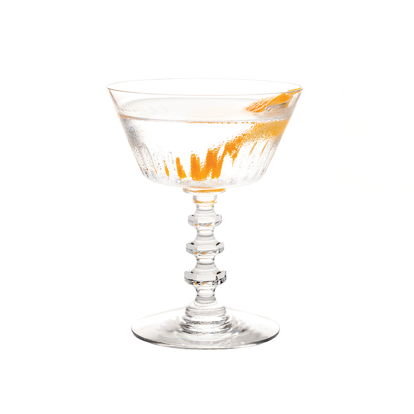 THE KLEO-PATRA JONES - 1 part KLEOS Mastiha Spirit2 parts gin                                          3 drops orange bittersStir all ingredients over ice for dilution.Strain into a chilled coupette.Garnish with an expressed orange peel.                       For the Bond girls and the men who love them.