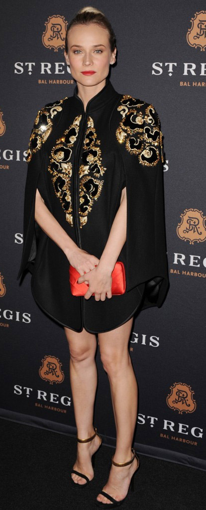 celebrity-trendsetter-style-type-fashion-dianekruger-black-cape-gold-embroidered-red-clutch-hair-bun-dressy.jpg